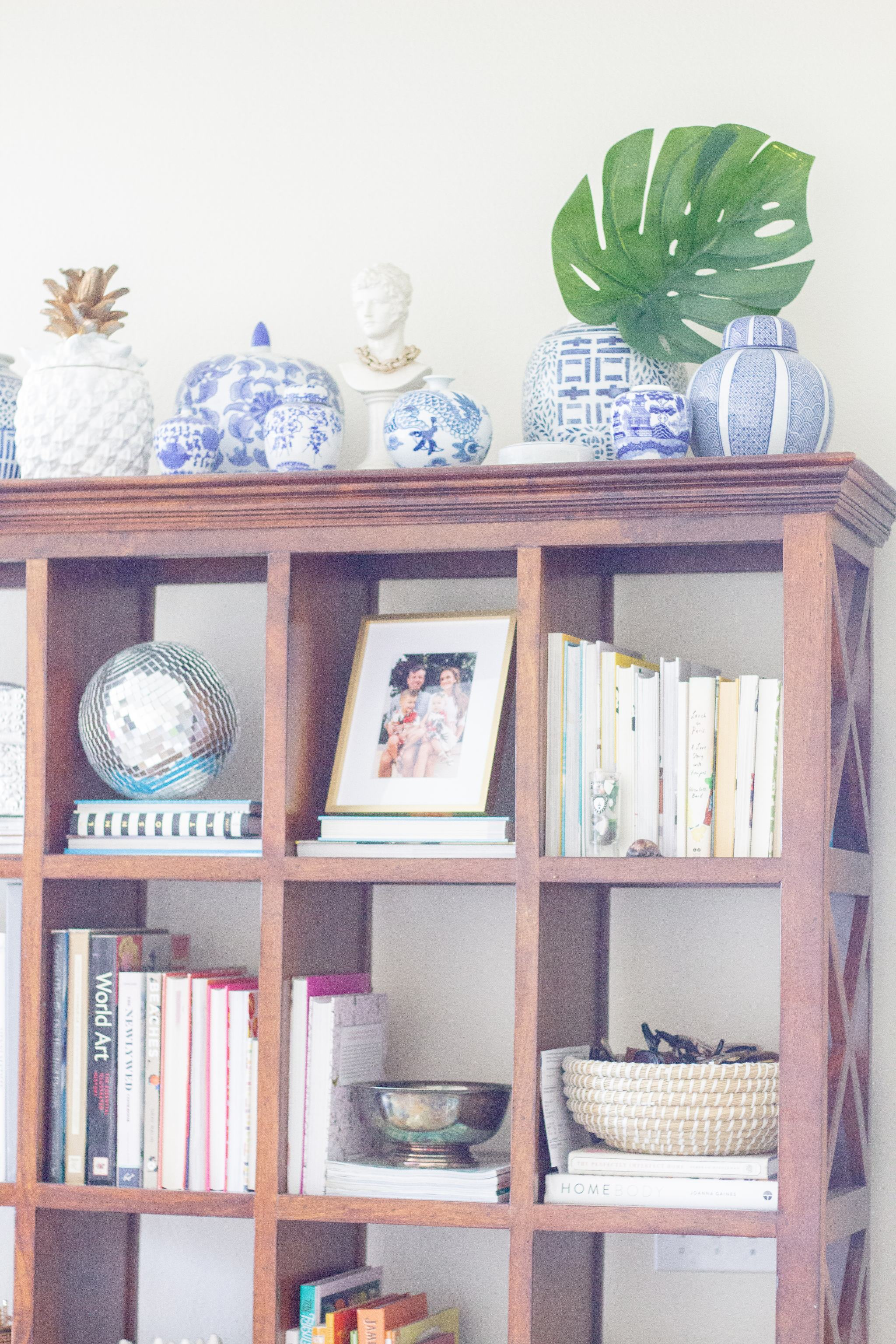tall bookcase - blue and white ginger jars - how to decorate a bookcase - bookshelf
