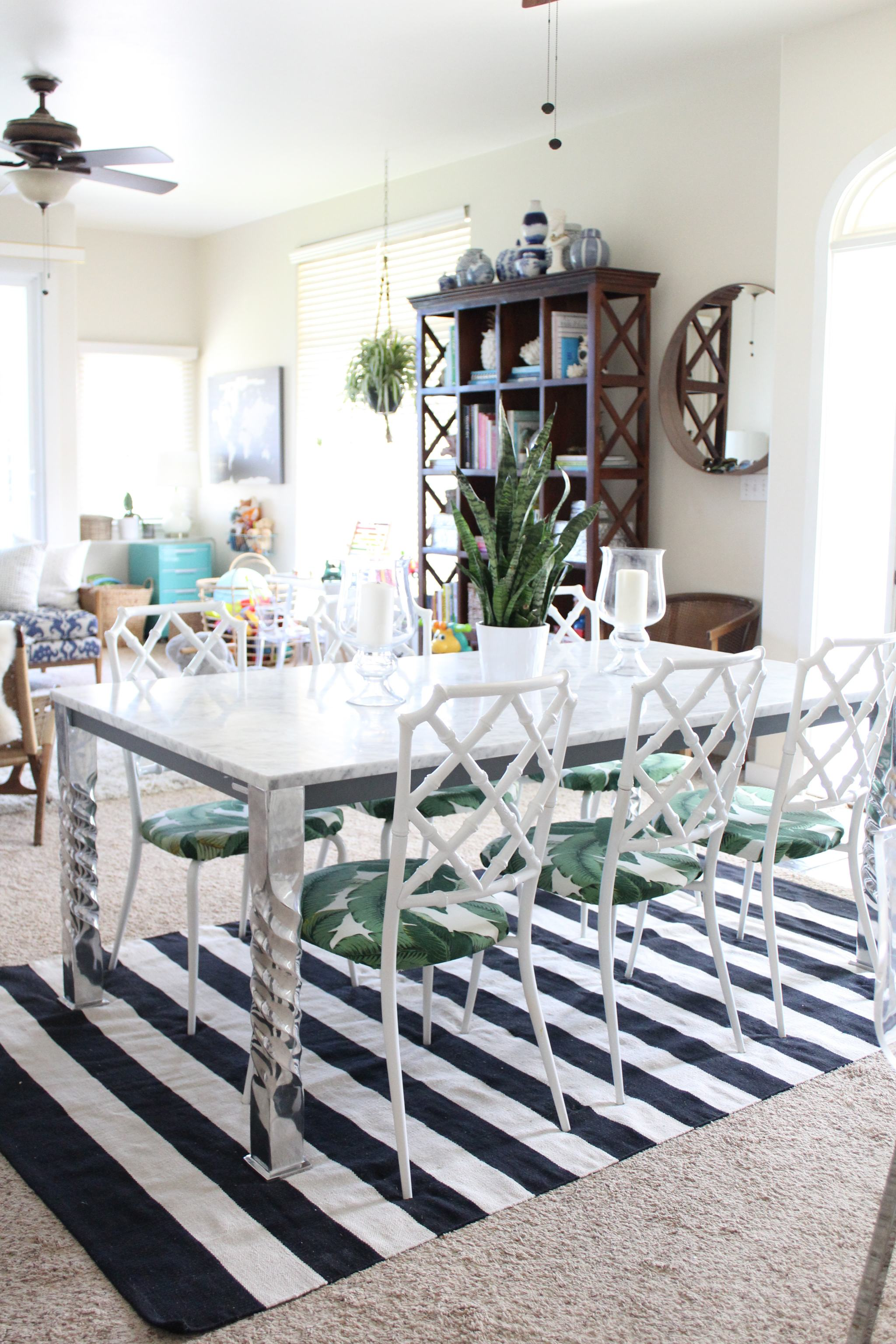 marble dining table - palm leaf fabric - faux bamboo dining chairs - striped rug