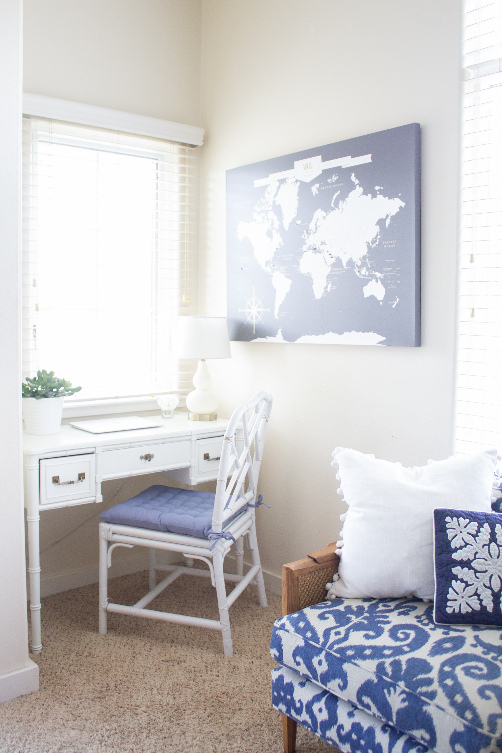 faux bamboo desk - Lacefield's Marrakesh Indigo Batik - faux bamboo vanity - chinese chippendale chair - chinese chippendale dining chair - writing nook - blue seat cushion - push pin travel map - blue and white sofa - vintage sofa - ikat sofa - home office