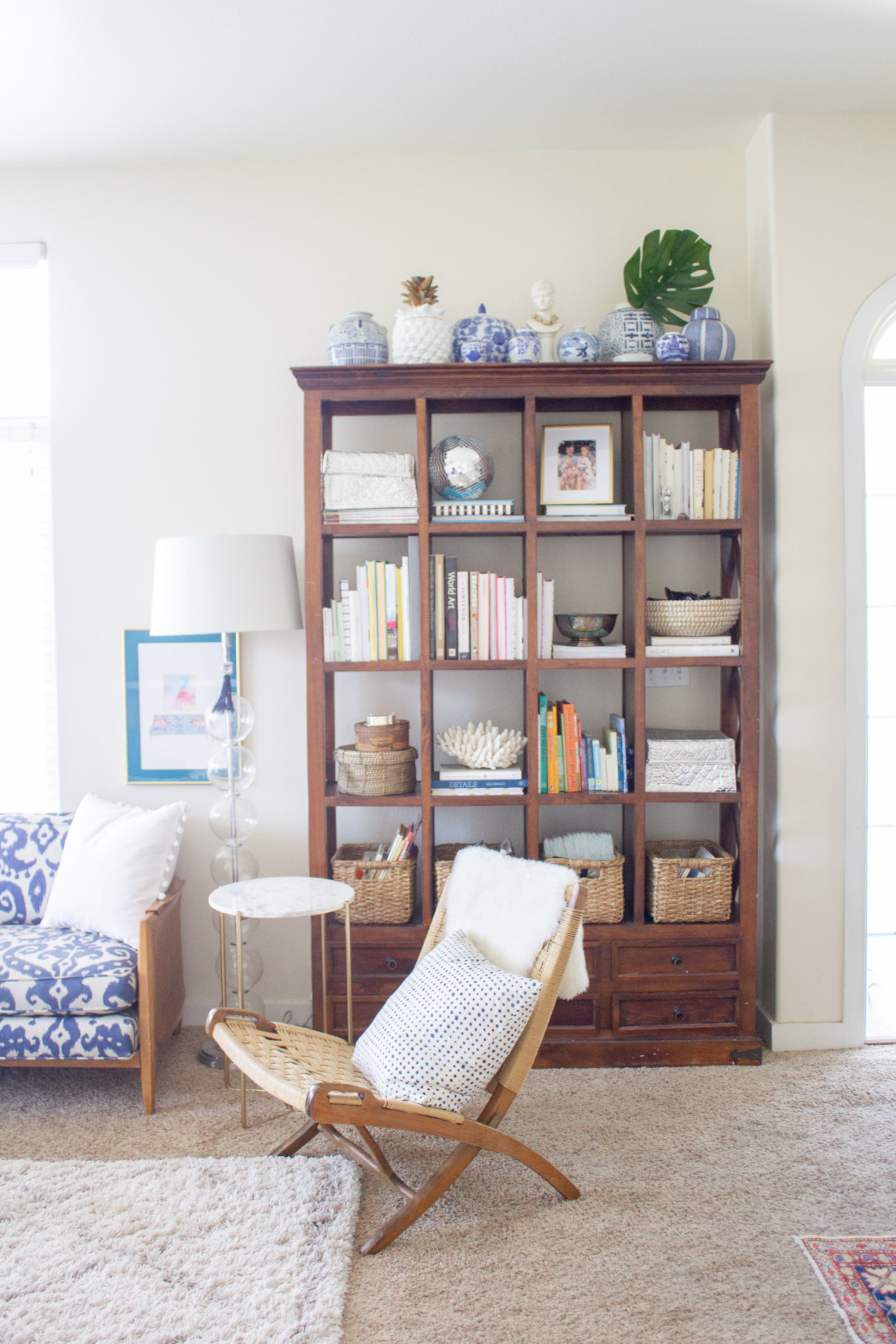 woven chair - tall bookcase - marble accent table - blue and white sofa - ikat sofa - vintage sofa