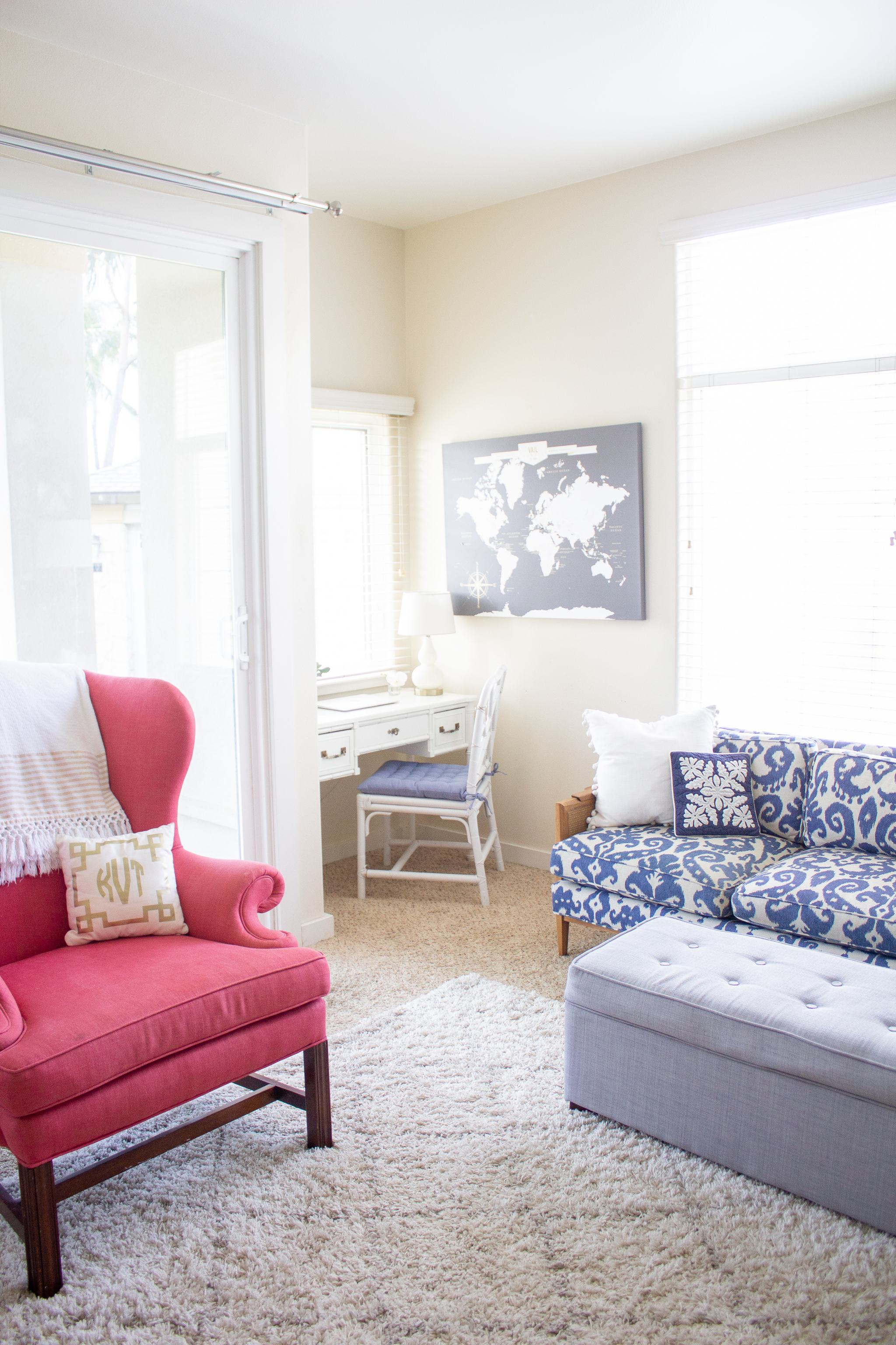faux bamboo desk - Lacefield's Marrakesh Indigo Batik- faux bamboo vanity - chinese chippendale chair - chinese chippendale dining chair - writing nook - blue seat cushion - push pin travel map - blue and white sofa - vintage sofa - ikat sofa - home office - pink wingback chair