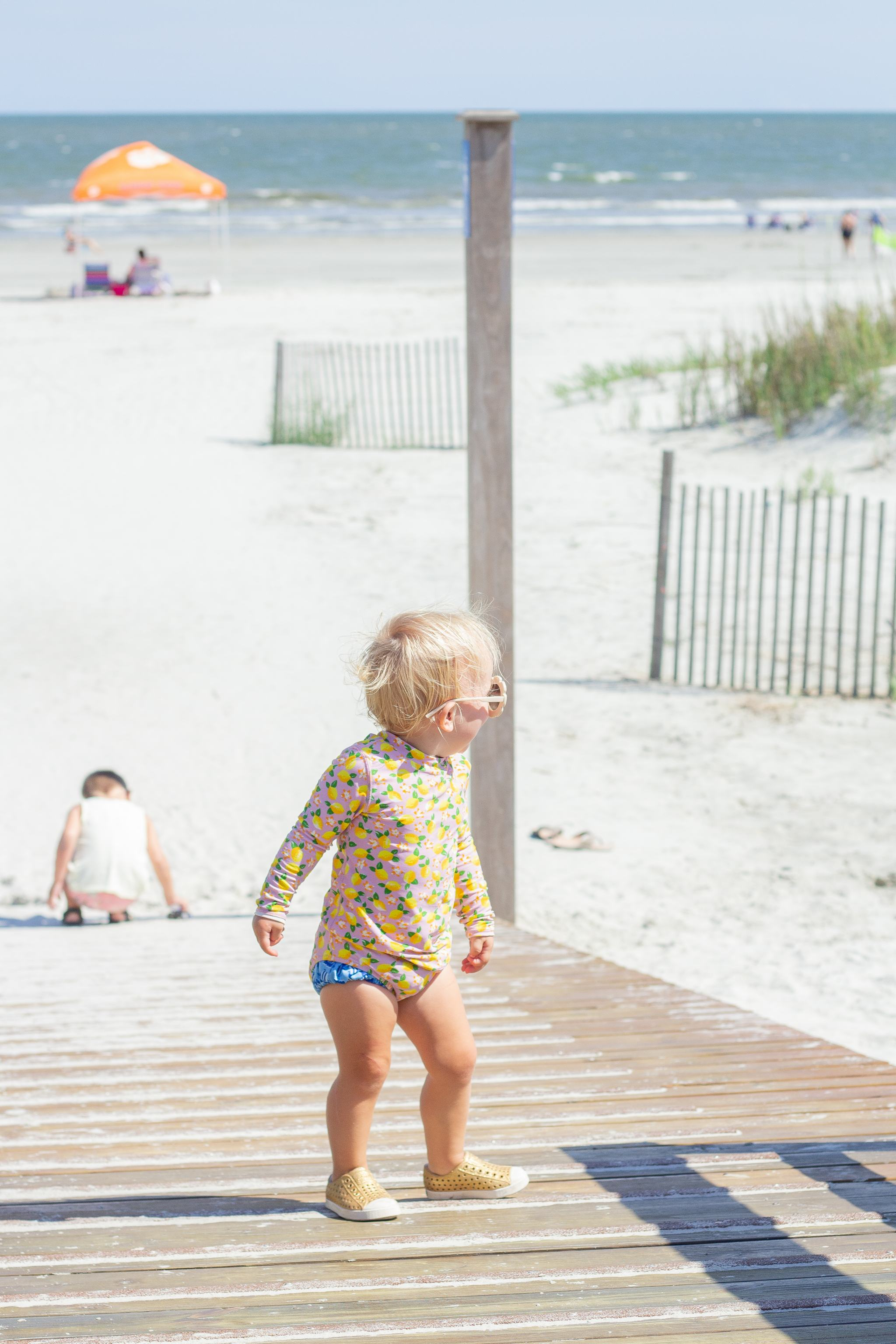 fripp island - south carolina - lowcountry - family beach vacation - jcrew factory lemon swimsuit - daisy sunglasses - flower sunglasses - father daughter picture - toddler girl style