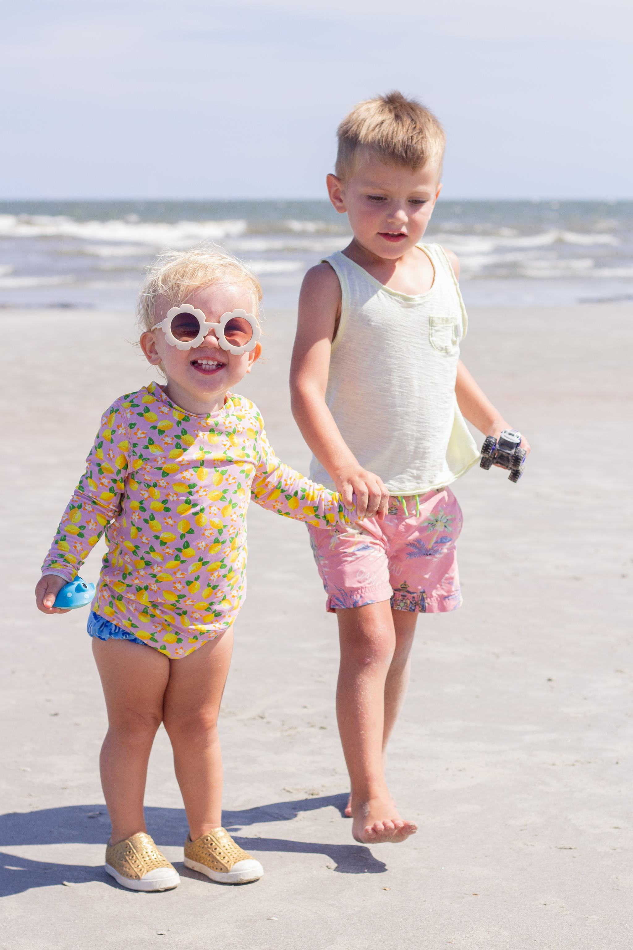 fripp island - south carolina - lowcountry - family beach vacation - jcrew factory lemon swimsuit - daisy sunglasses - flower sunglasses - sibling beach photo - toddler girl style