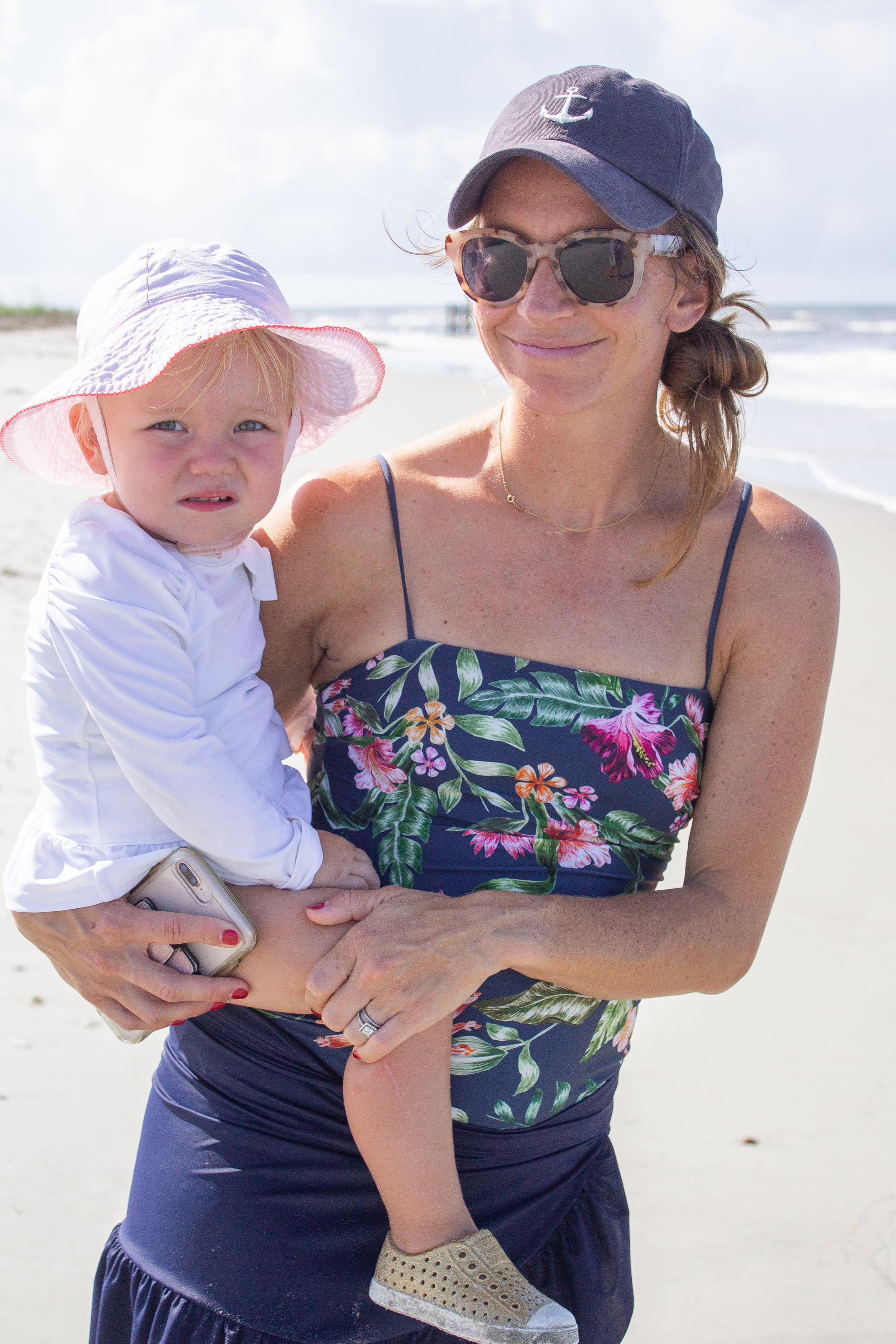 fripp island - south carolina - boating - lowcountry - shell island - toddler outfit inspiration - toddler boy style - toddler girl style - hm swimsuit - 14 weeks pregnant - jcrew factory wrap skirt - navy anchor baseball cap