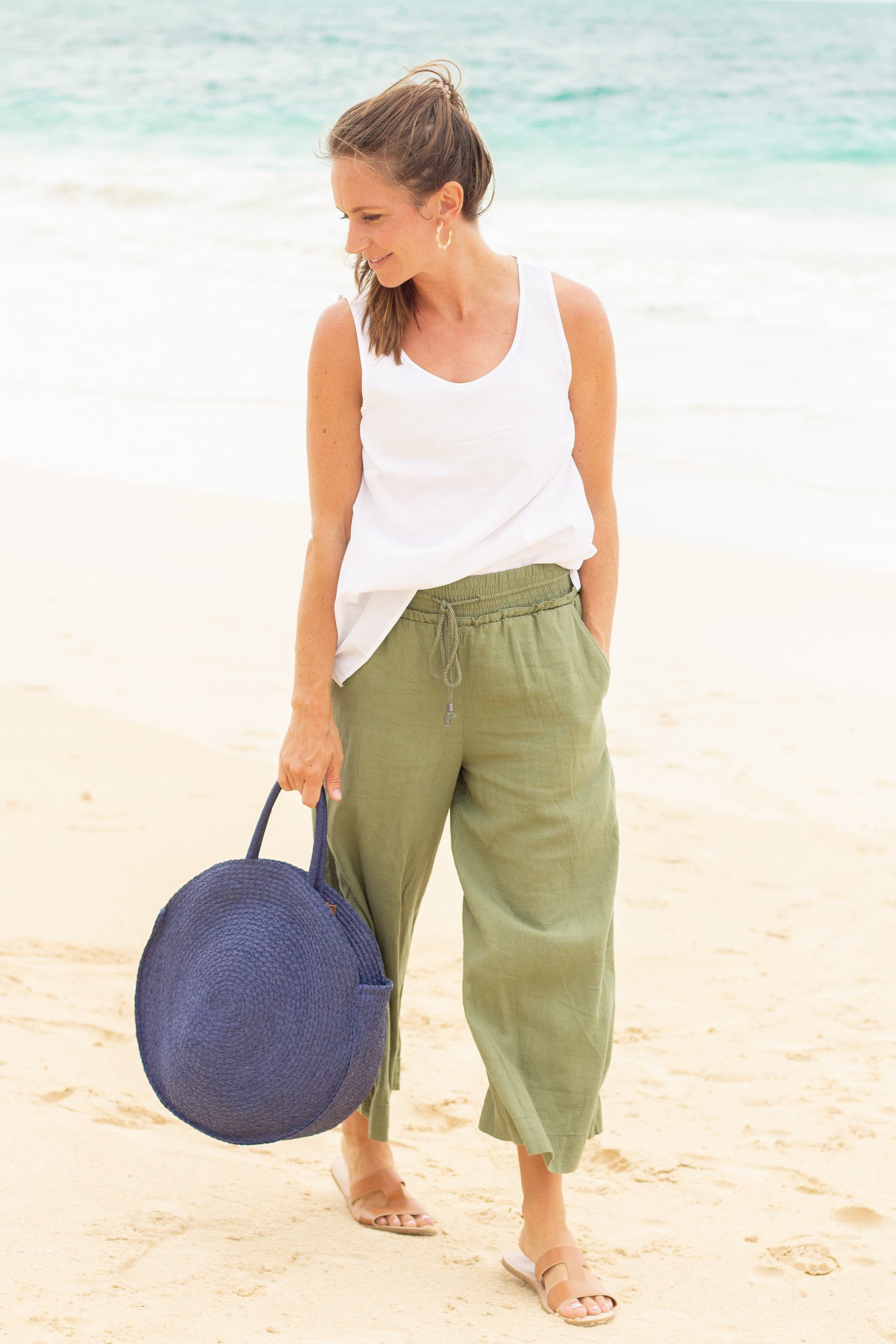 linen pants - wide leg linen pants - walmart fashion - we dress america - navy straw round tote - brown leather h band sandals - time and true - walmart style - summer style - olive green wide leg linen pants - white shell top - gold scallop hoop earrings - bellows- beach fashion - beach vacation outfit