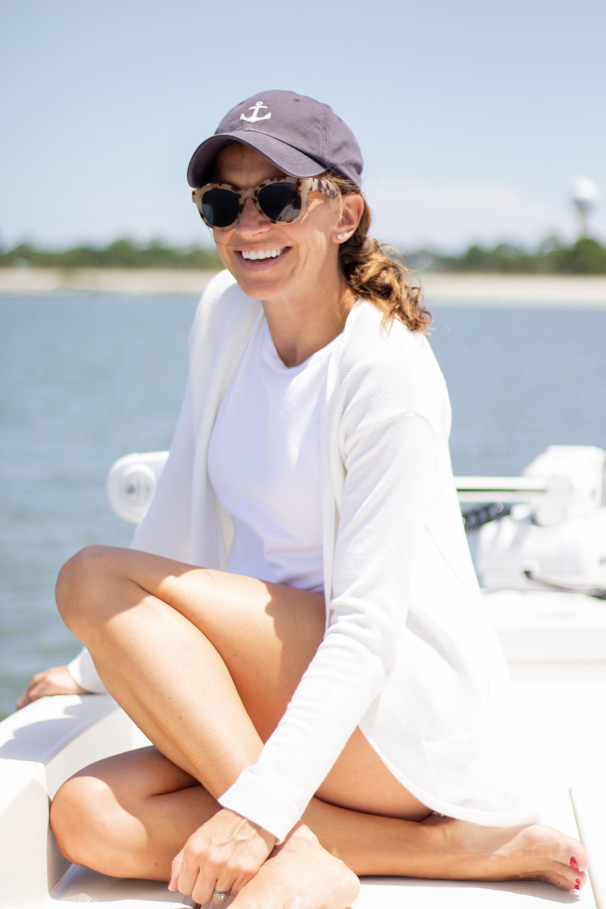 fripp island - lowcountry vacation - family beach vacation - boating outfit idea - madison mathews gingham shorts - walmart high neck tank top - tortoise shell sunglasses - navy baseball cap