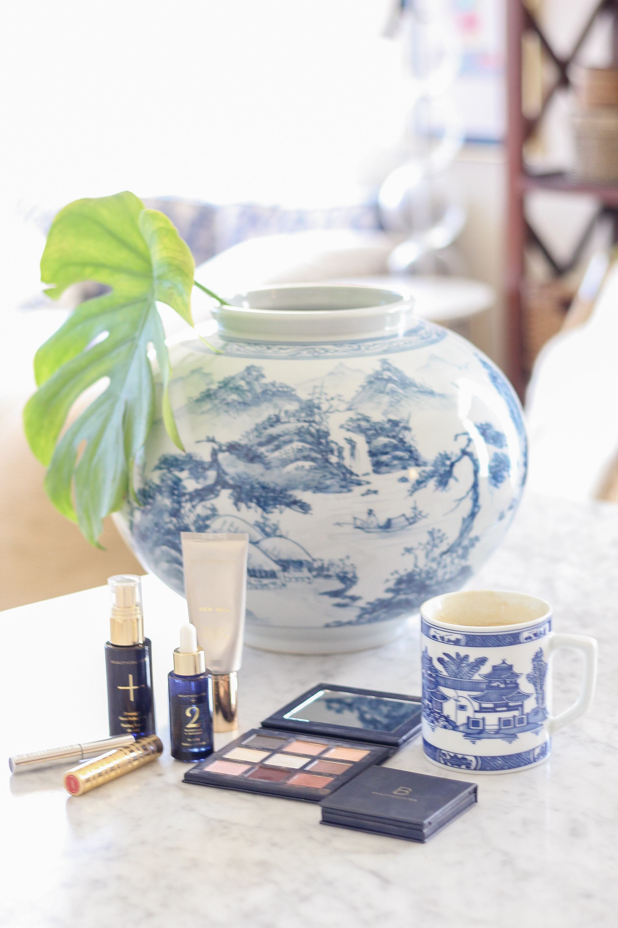 classic style - blue and white dress - living room decor - what it's like to be a beautycounter consultant - being a beautycounter consultant - how do you become a beautycounter consultant - tuckernuck earrings - how much do beautycounter consultants make - clean beauty - better beauty - preppy style - blue and white pottery - blue willow