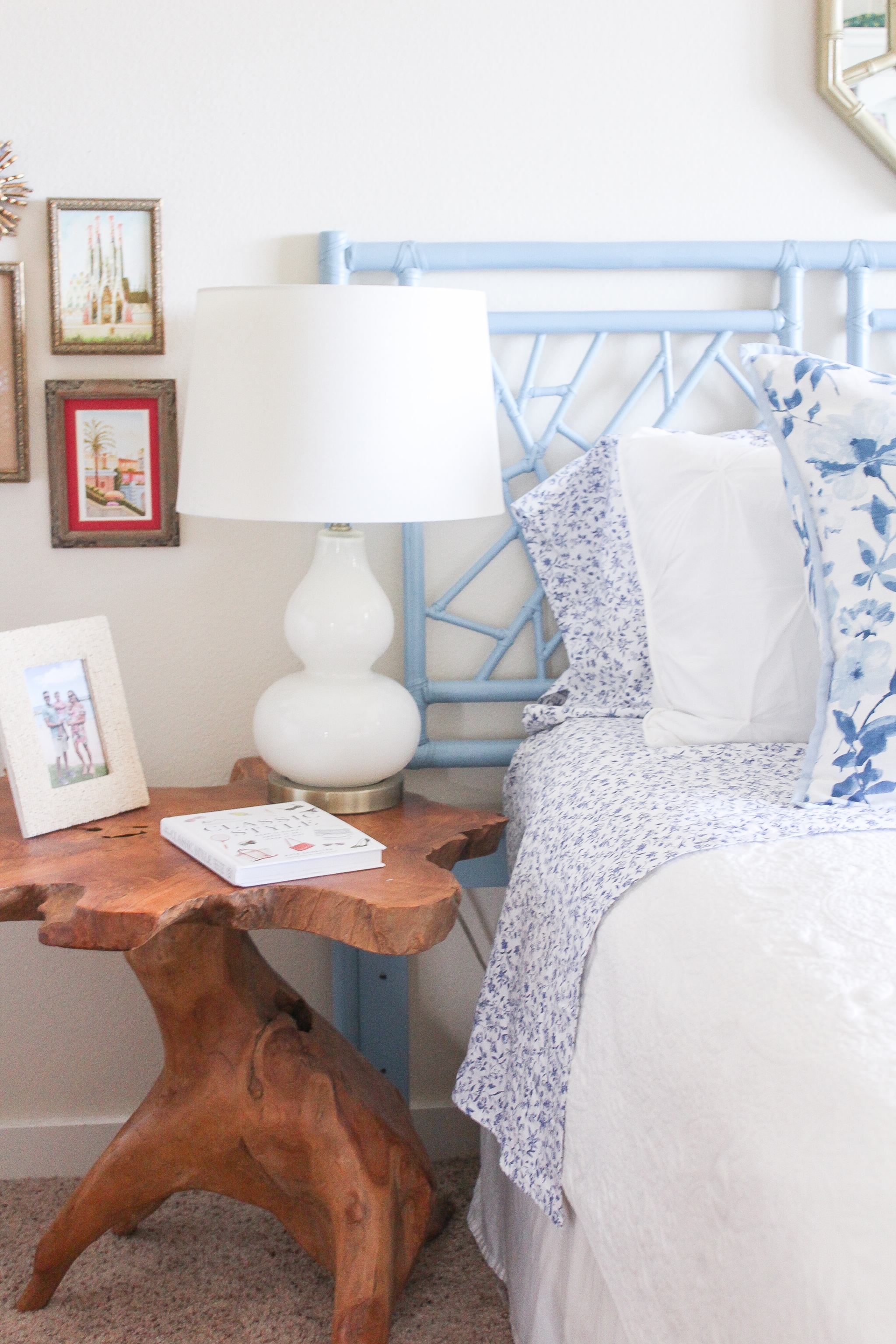 blue and white bedroom - faux bamboo mirror - vintage mirror - vintage bamboo headboard - vintage rattan headboard - blue rattan headboard - headboard DIY - hats on wall - rattan bookcase - rattan bookshelf - classic style - coastal style - monogrammed tote bag - bedroom inspo - bedroom decor - blue and white floral sheets - blue and white floral pillows - tuckernuck bow sunhat - raw edge table - hanging wall hooks - hanging wall hook rack - longchamp tote - preppy style