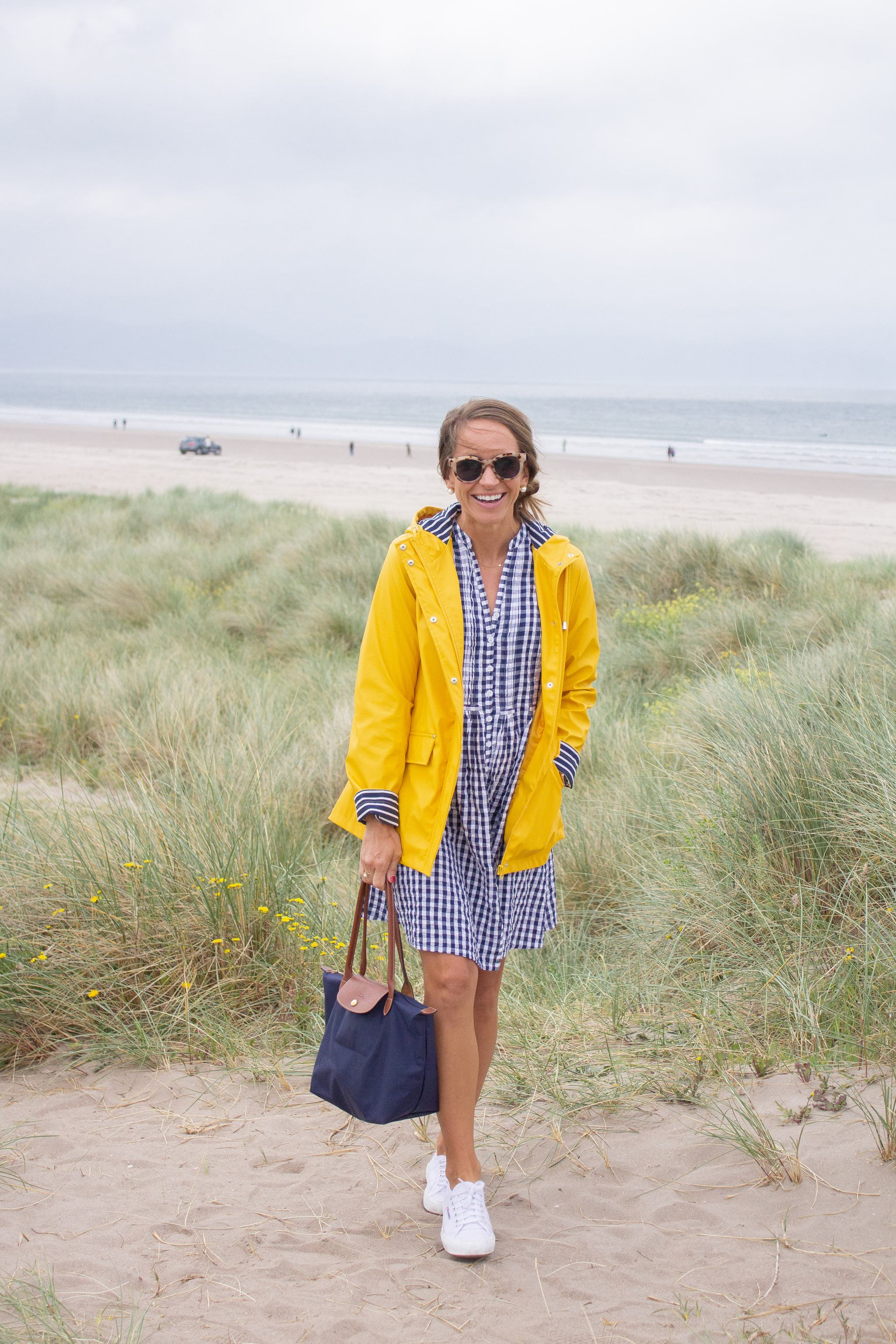 classic style - maternity style - second trimester outfit idea - pregnancy style - superga cotu sneakers - dingle peninsula - blue and yellow outfit - white superga sneakers - white sneakers with a dress - dress and sneakers - gingham dress - madison mathews juliette dress - blue and white gingham - yellow rain jacket - traveling in Ireland