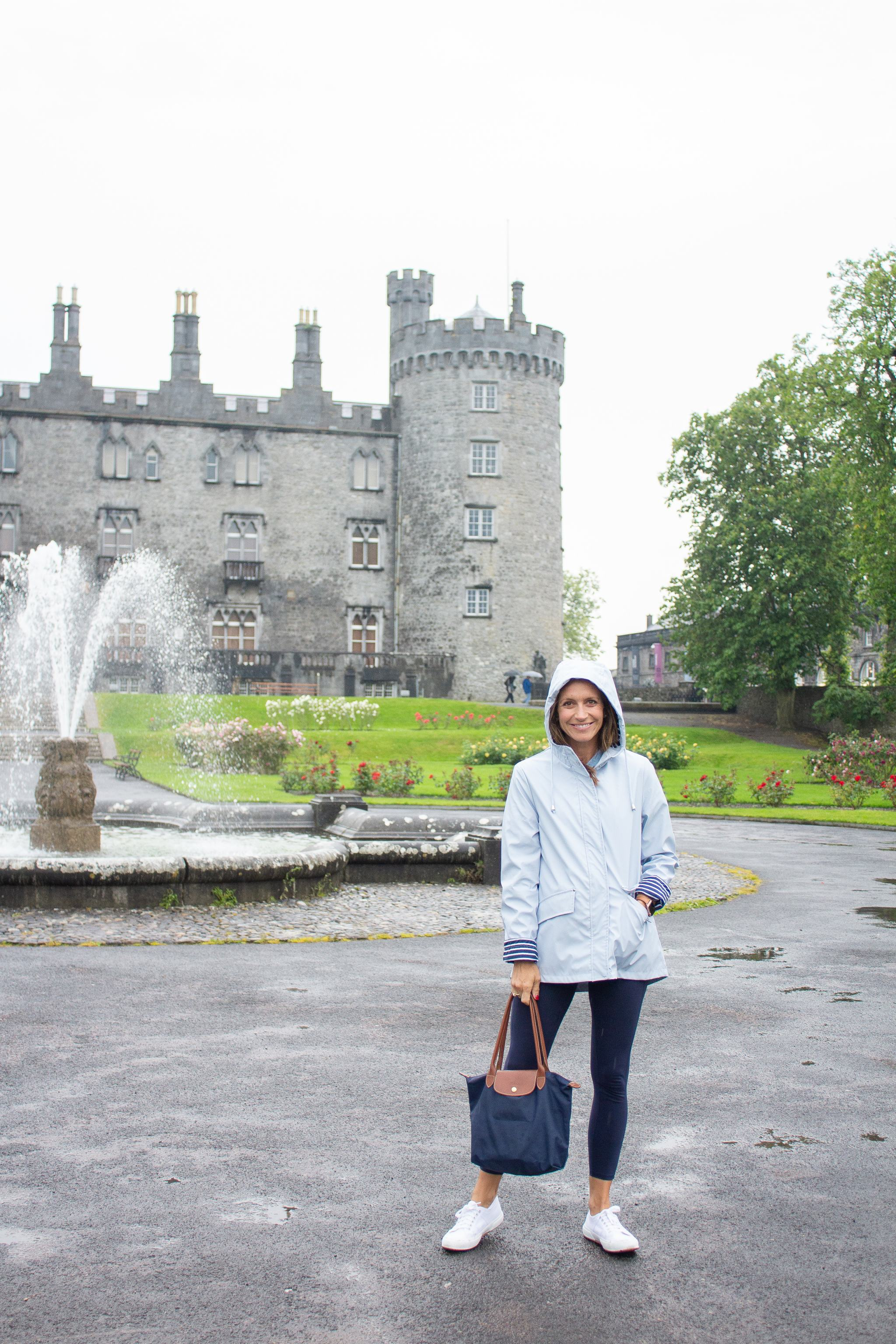 classic style - maternity style - second trimester outfit idea - pregnancy style - colorfulkoala leggings - amazon leggings - superga cotu sneakers - white superga sneakers - cute rain jacket - traveling in Ireland - killkenny castle - sneakers and leggings -