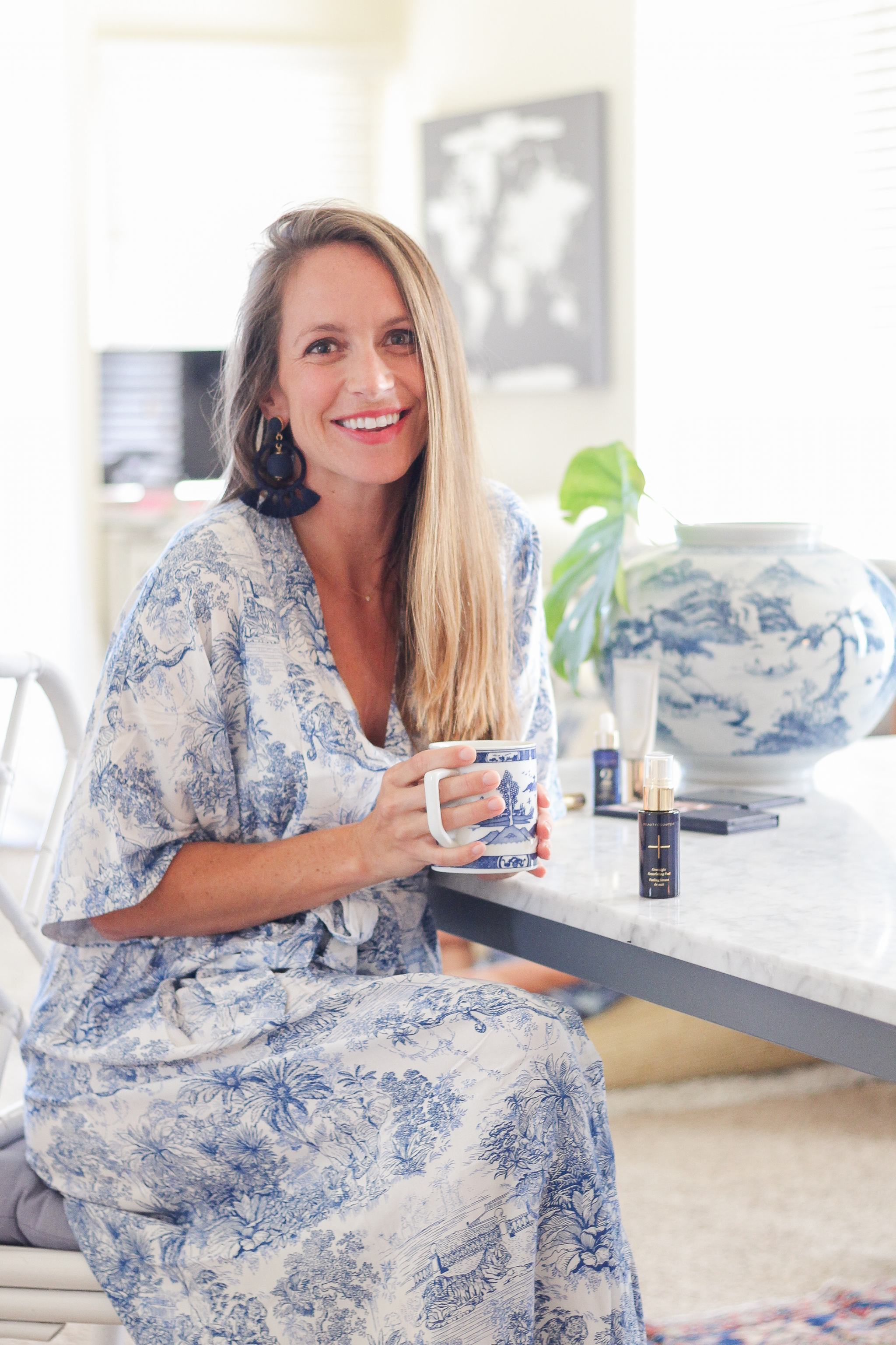 classic style - blue and white dress - living room decor - what it's like to be a beautycounter consultant - being a beautycounter consultant - how do you become a beautycounter consultant - tuckernuck earrings - how much do beautycounter consultants make - clean beauty - better beauty - preppy style - blue and white caftan - caftan