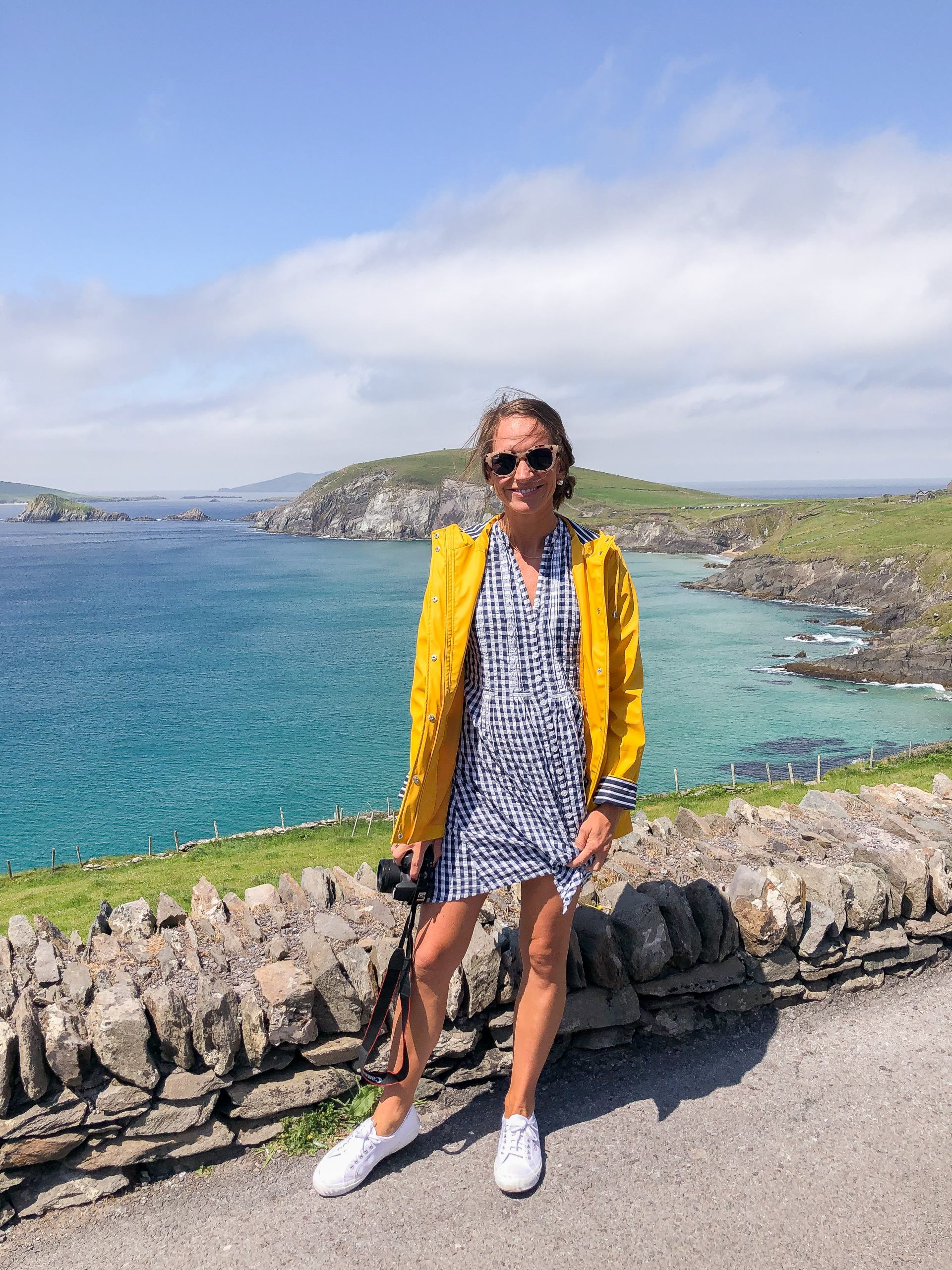 traveling in ireland - travel style - travel outfit inspo - yellow rain jacket - madison mathews dress - dingle peninsula