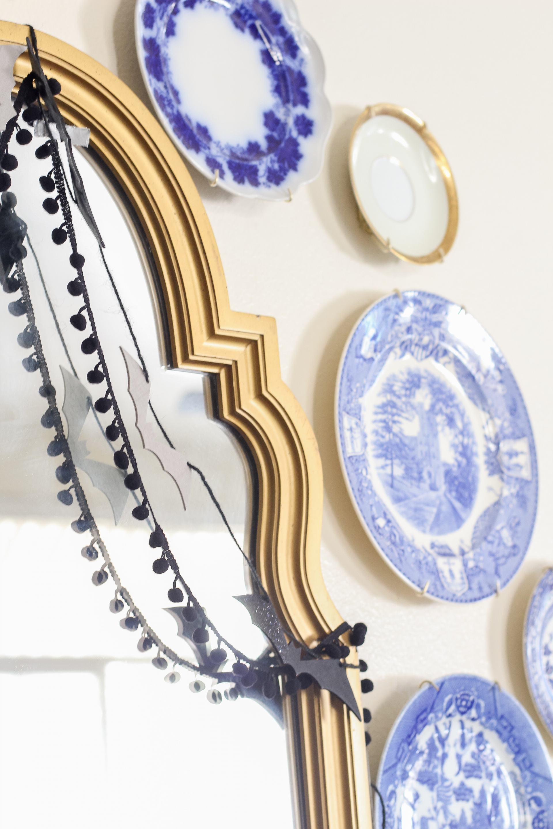 plates on wall - plate gallery wall - blue and white plate wall - blue and white fall decor - fall decorating ideas - classic fall style - bats on wall halloween - simple halloween decor - simple fall decor - blue and white pumpkins - kid craft halloween ideas - halloween garland - coastal style halloween - coastal style fall - painted pumpkins - paper mache pumpkins - affordable halloween decor - affordable fall decor - minimal fall decorating