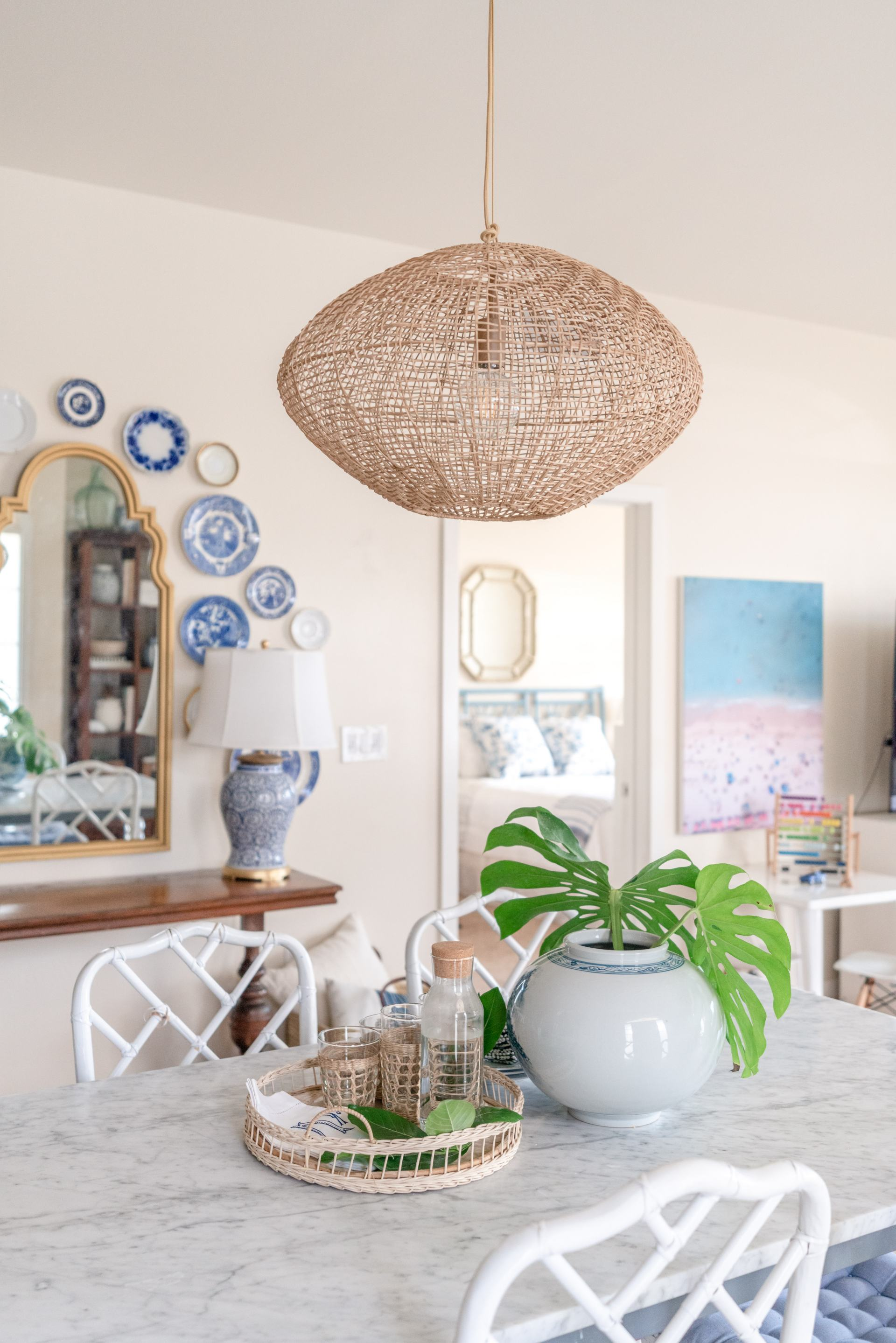 the everymom home tour - hawaii home - beachy decor - woven chandelier - plate wall - plates hanging on wall - plate gallery wall - blue and white plates - aerial photography - stripes and whimsy - katie vail home