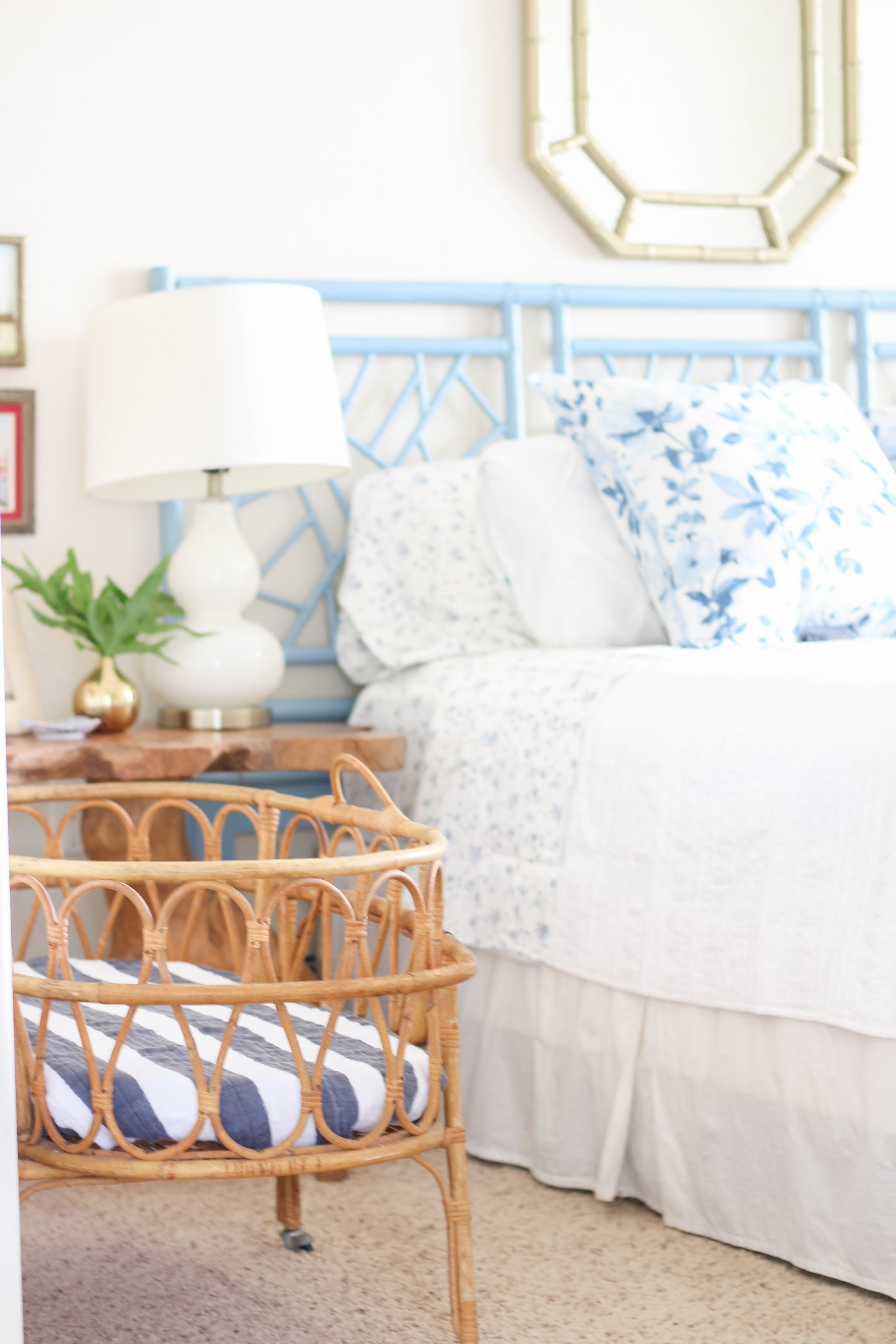 vintage bassinet - rattan bassinet - baby number 3 - small space living with baby - third baby - newborn plan - wicker bassinet - classic style - blue and white master bedroom - rattan headboard - vintage rattan