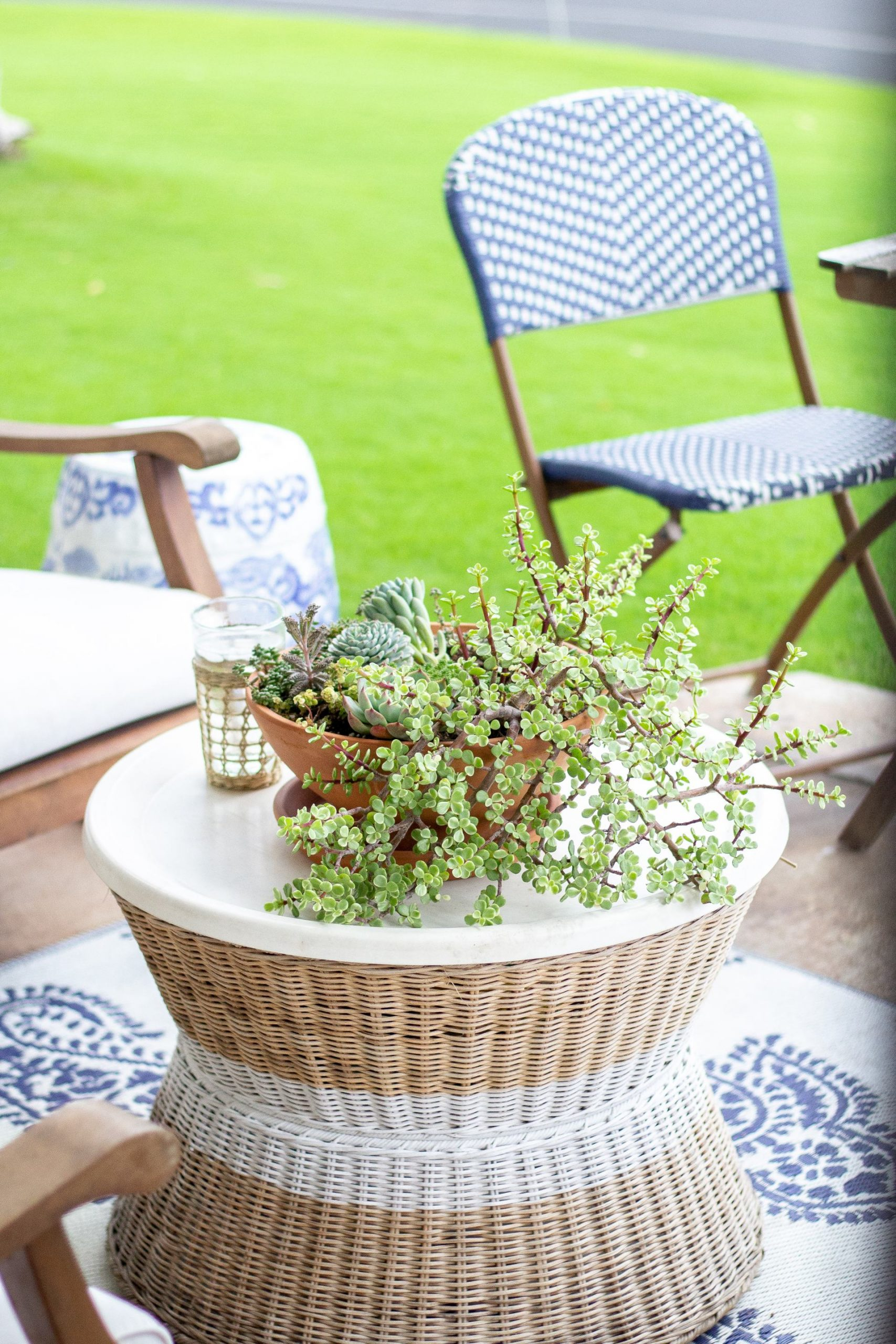 serena and lily style - patio decor - outdoor decor - blue and white - coastal style - nautical style - serena and lily inspo - outdoor furniture - porch decor - outdoor living - outdoor spaces - bistro table - bistro chair - bistro set - stripes - outdoor rug