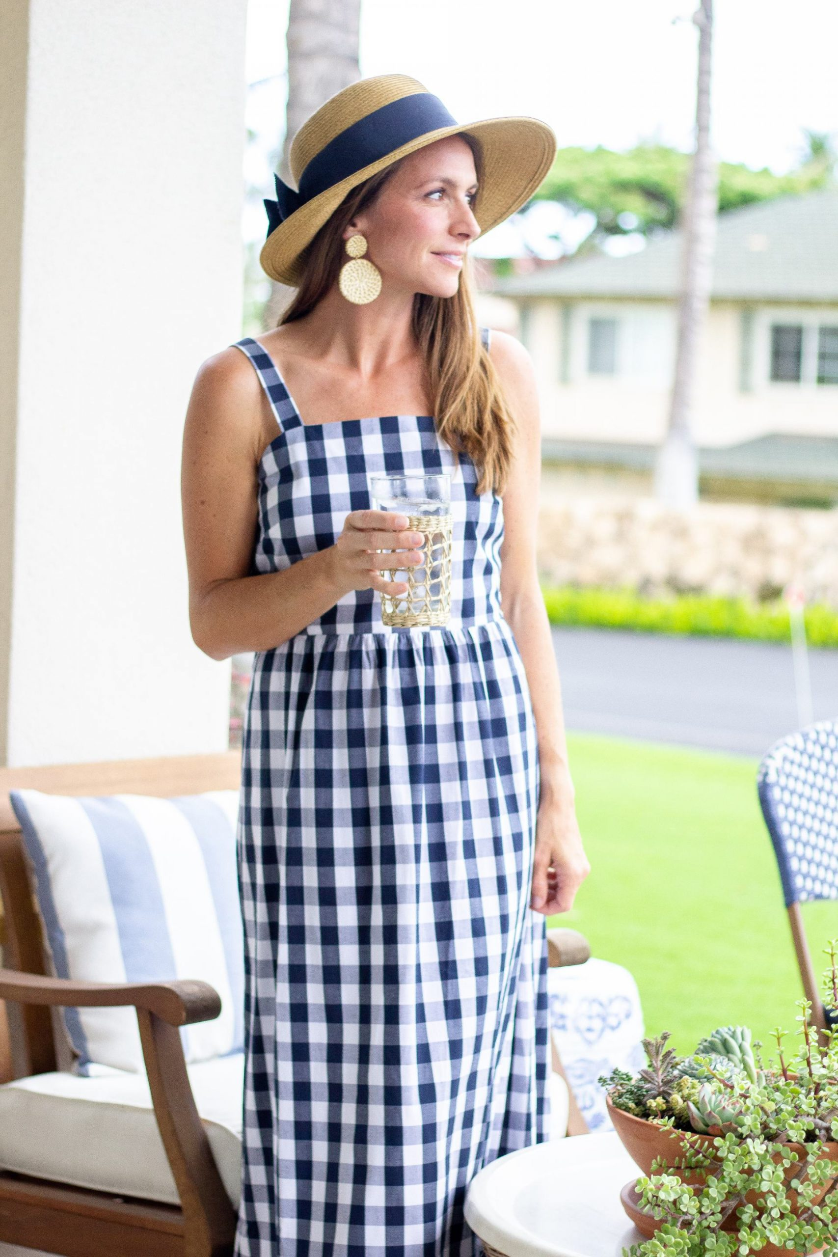 serena and lily style - patio decor - outdoor decor - blue and white - coastal style - nautical style - serena and lily inspo - outdoor furniture - porch decor - outdoor living - outdoor spaces - bistro table - bistro chair - bistro set - stripes - outdoor rug - blue and white dress - gingham dress - coastal style - rattan earrings - tuckernuck bow sunhat