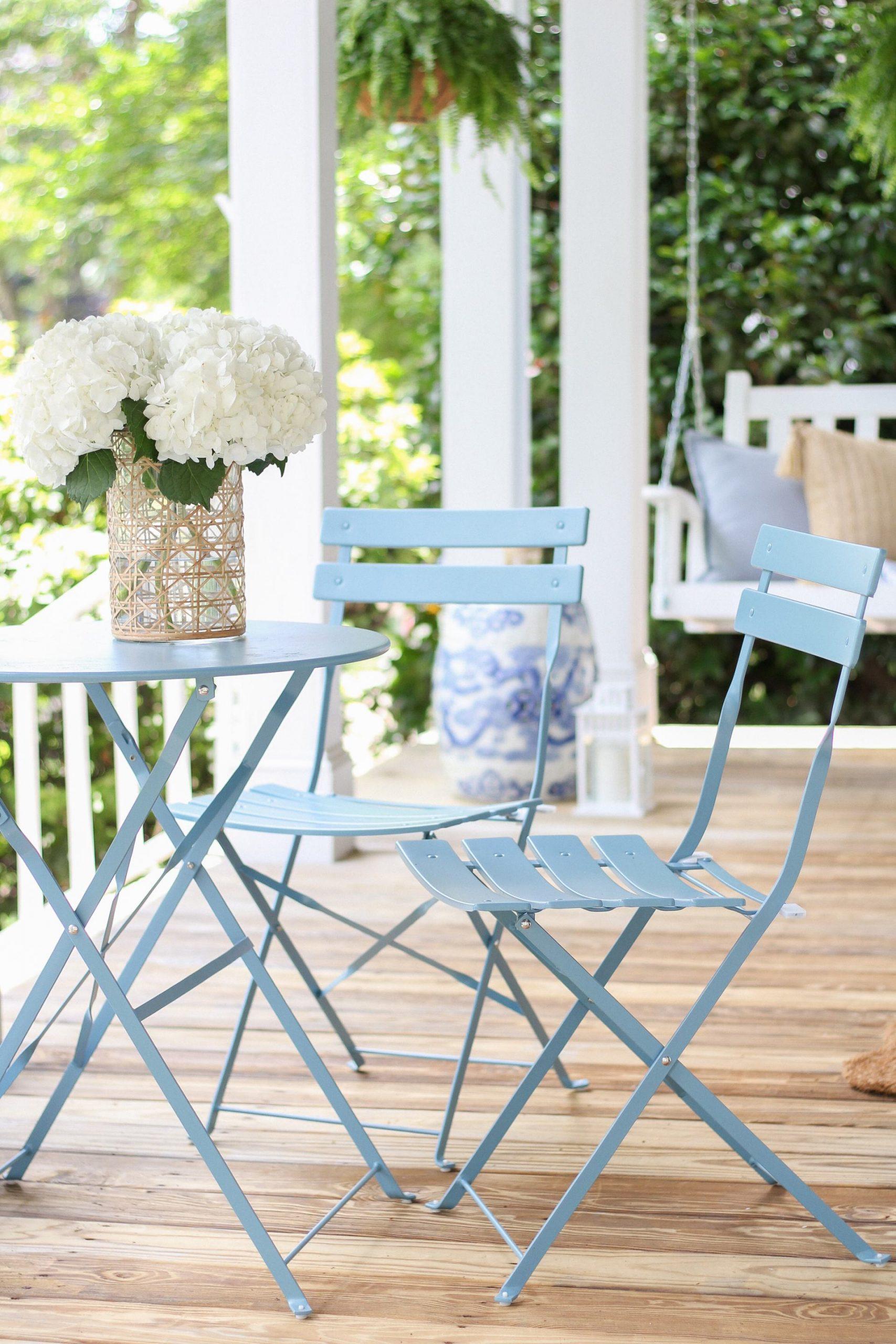 blue bistro set on front porch