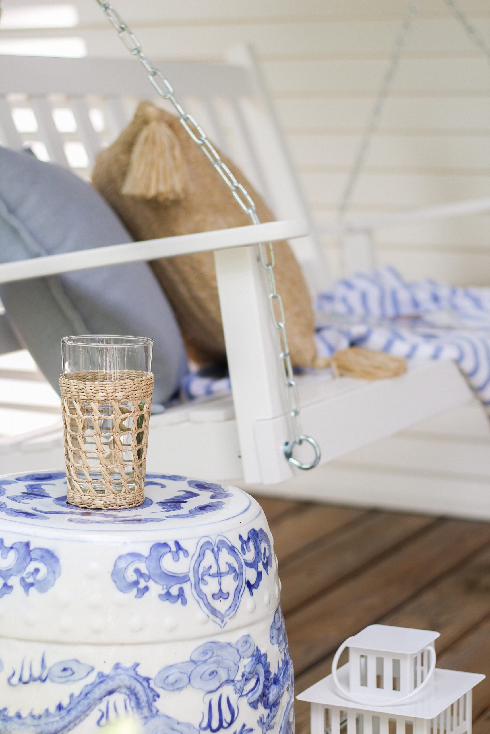 cane wrapped drinking glass on blue and white ginger jar