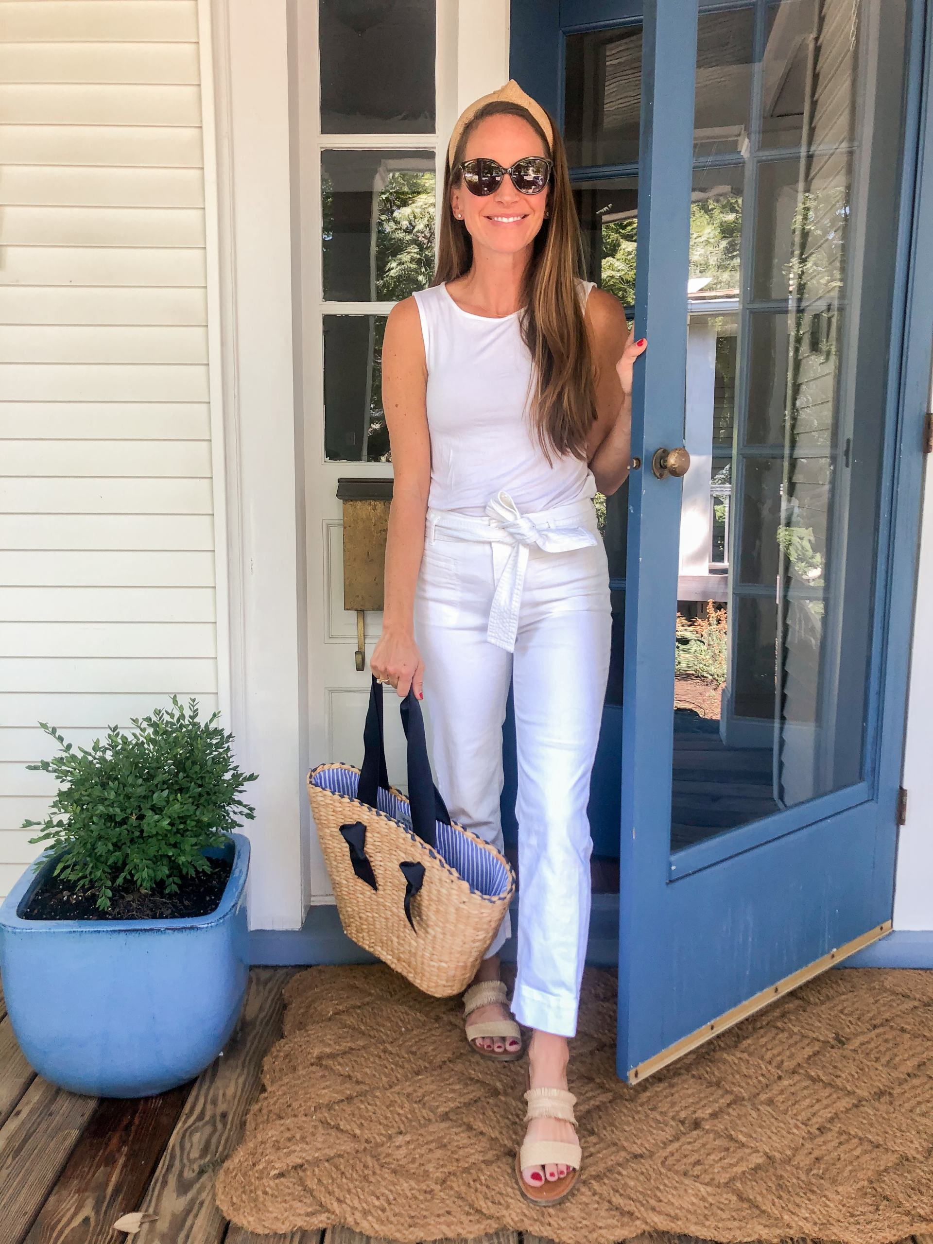 white monochromatic outfit with woven sandals woven knot headband and basket bag with ribbon handles