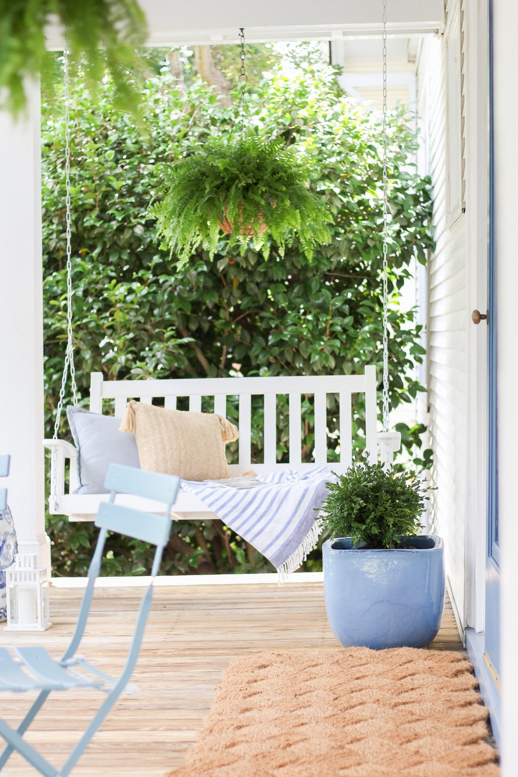 front porch swing with blue and white accents