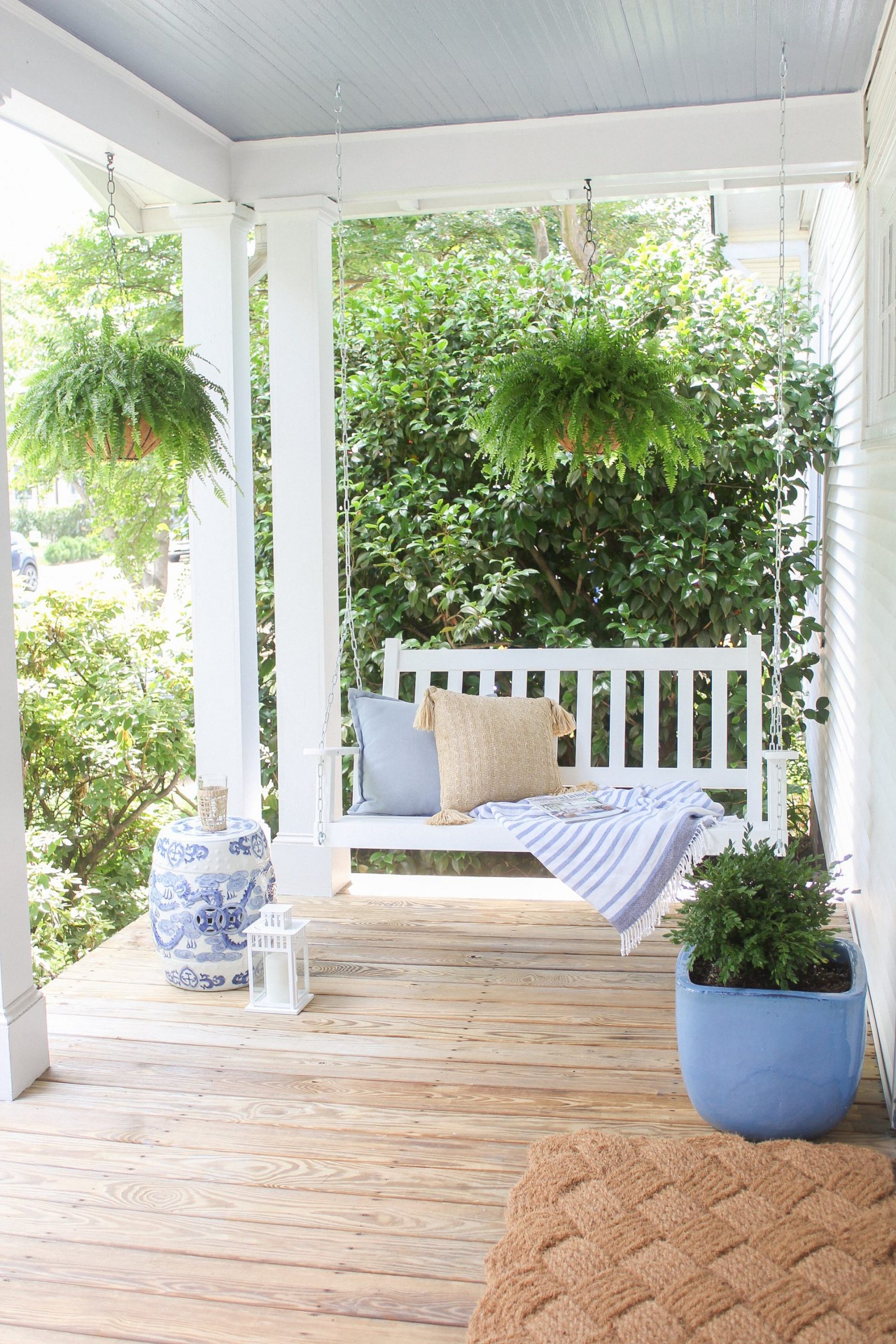 front porch with swing and hanging ferns