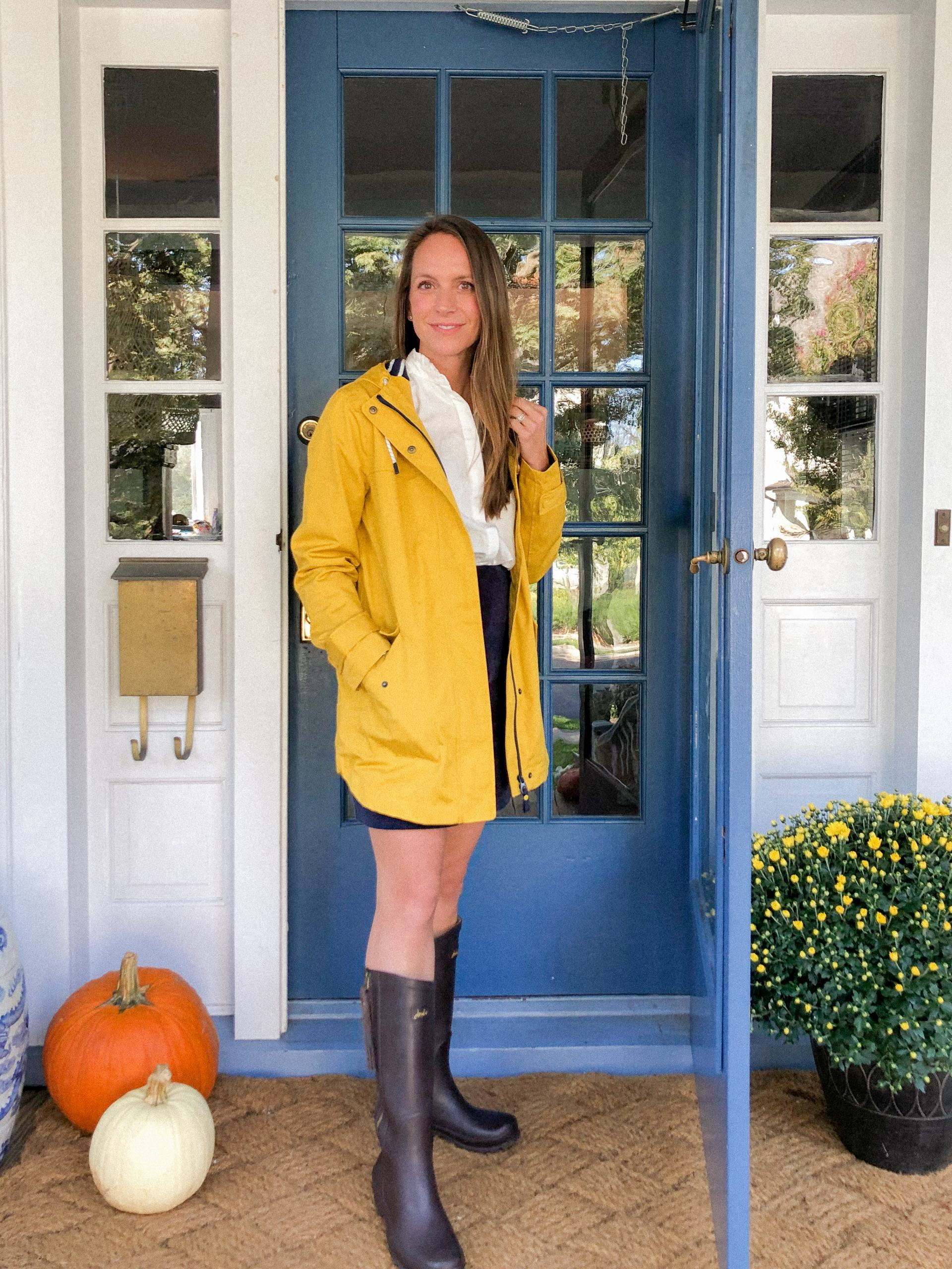 yellow rain jacket with corduroy skirt and brown riding boots