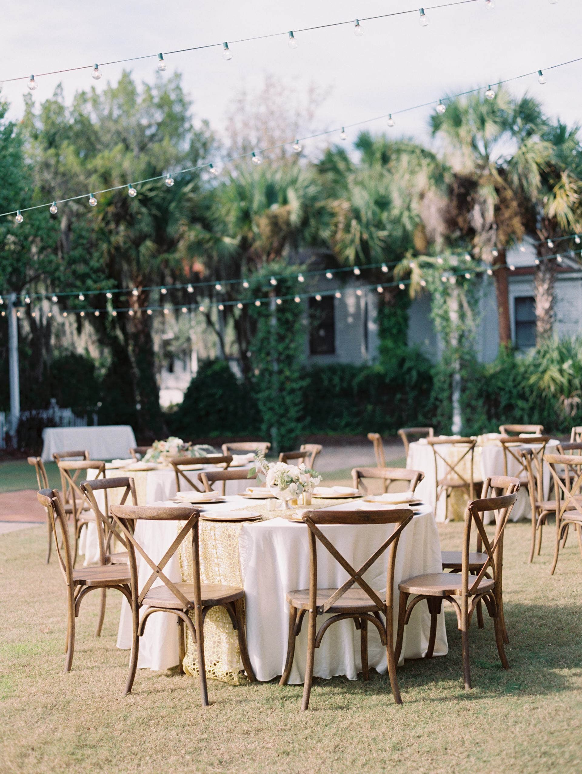 tables and string lights wedding reception