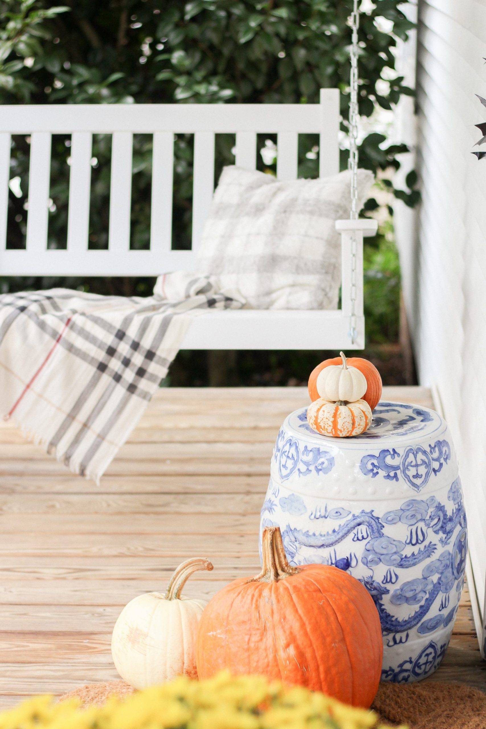 pumpkins and blue and white garden stool