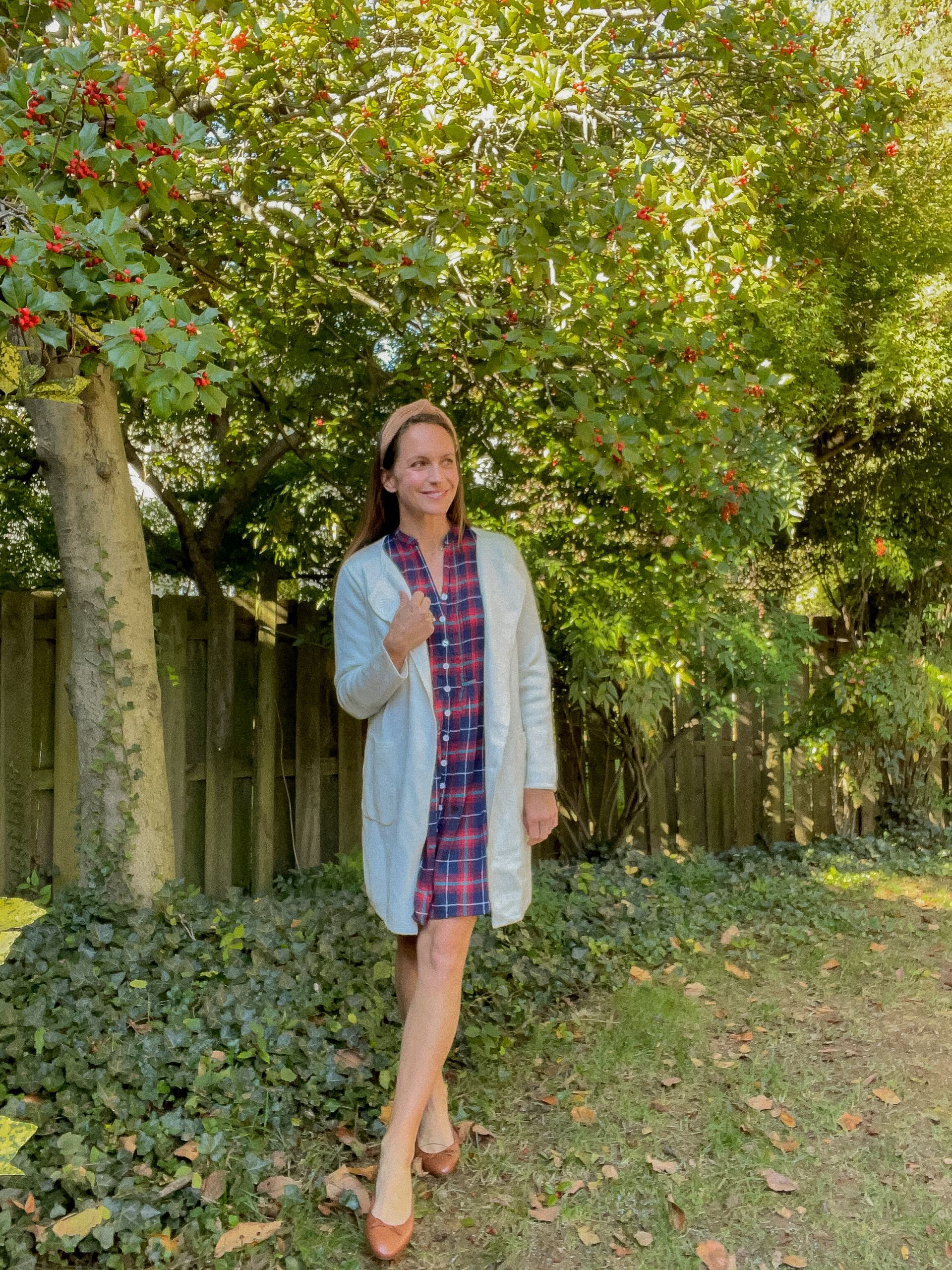 plaid dress with sweater and ballet flats