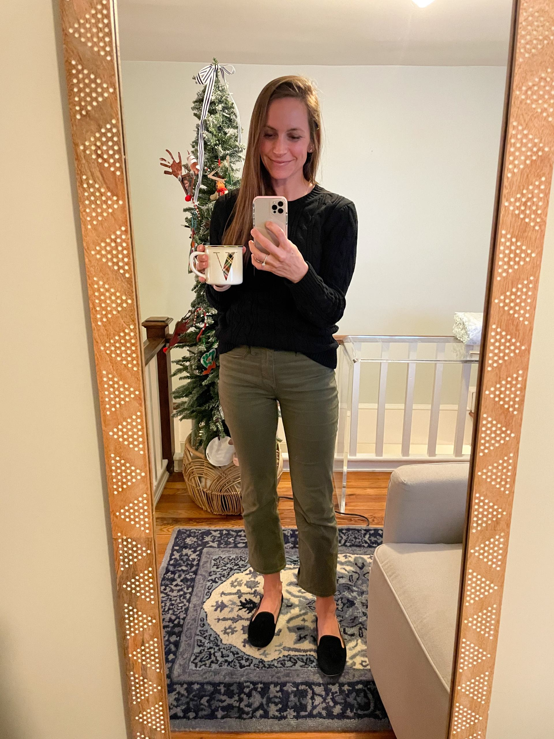 olive green pants and black sweater
