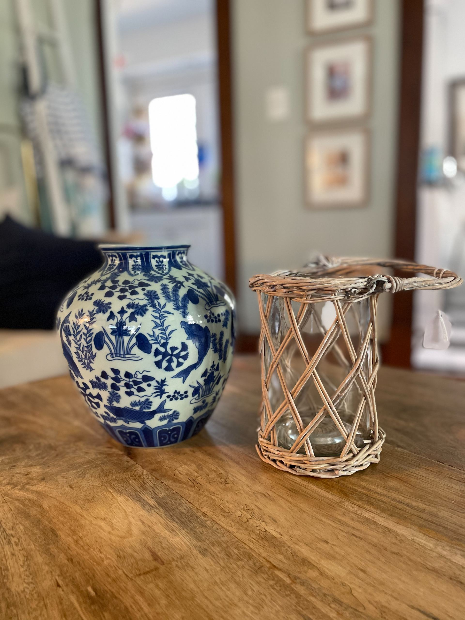 blue and white vase and rattan hurricane