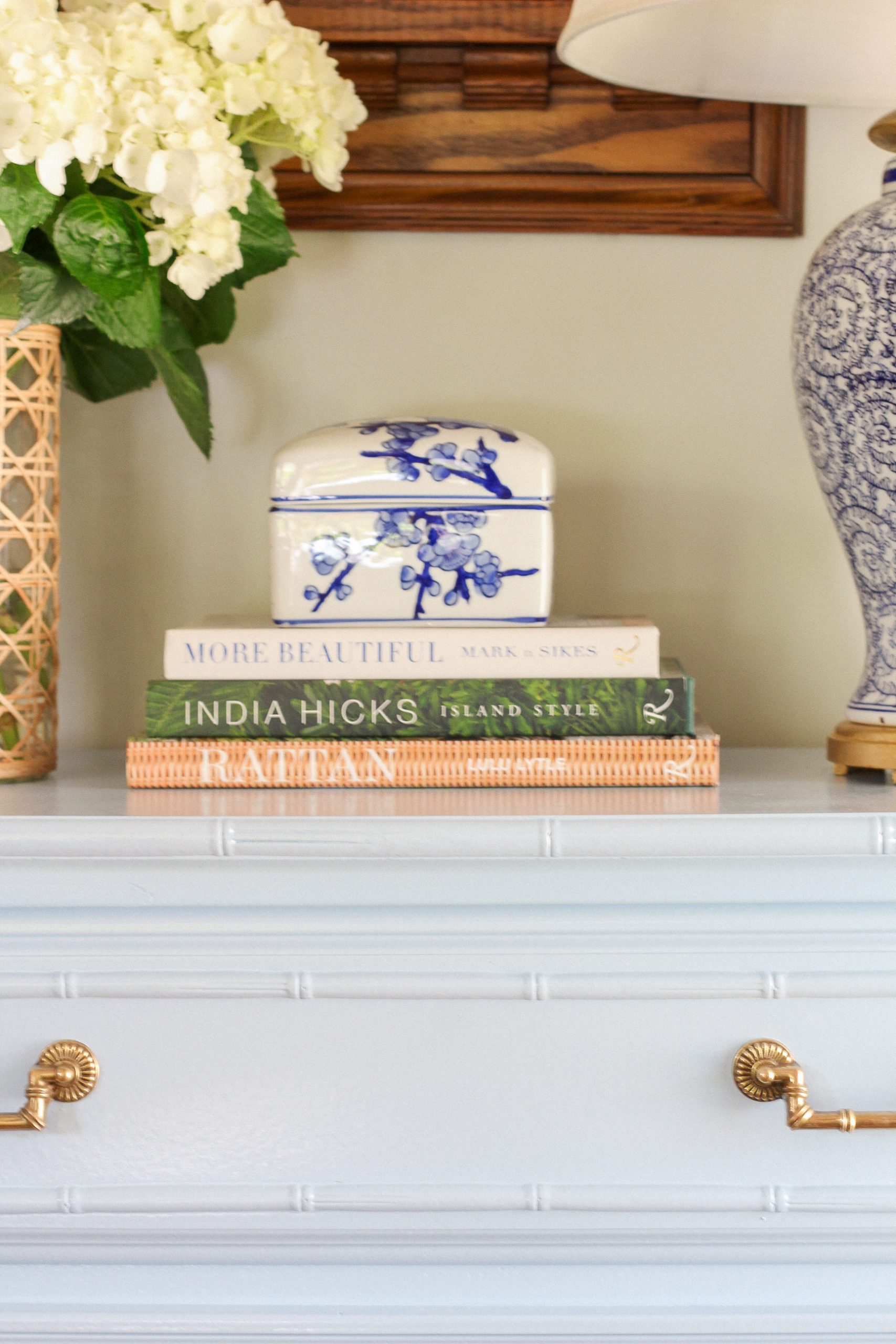 faux bamboo dresser and books