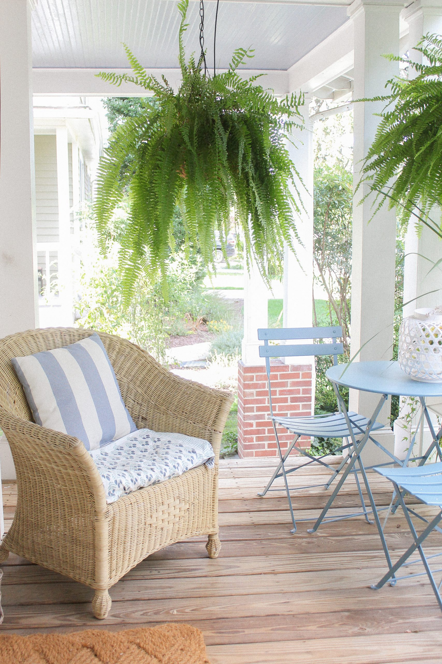 automatic watering system - amazon watering kit - potted plants - gardening tips - diy watering system - boxwoods - hanging boston ferns - flower box planning - craftsman front porch - wicker chair
